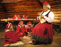 Photo: Mrs Clause - wife of Santa Claus - with elves in Lapland in Finland: House Christmas Cottage of Mrs. Santa Claus in Rovaniemi Santa Claus Wife, Santa Claus Village, Santa's Village, Lappland, Father Christmas, Christmas Art, Mrs Clause Costume, Santa Costume, Lapland Finland