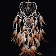 Handcrafted Tan Dream Catcher made with heart shape rings and black, red and white beads and tan feathers. Absolutely beautiful! Great for home decor or gift for birthday or christmas