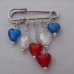 Kilt pin with red, white and blue hearts. this would be great for childrens' birth stones also.