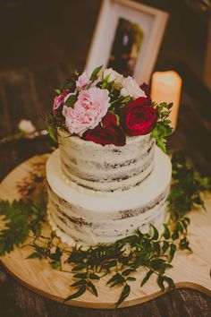Naked cake topped with roses and peonies. Love the vine around the base too!