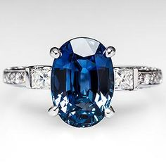 Oval Sapphire Engagement Ring w/ Diamond Accents in Platinum