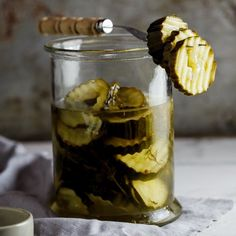 Delicious home-made sweet and sour pickles flavored with dill and garlic.