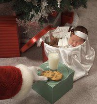 Nolan asleep by the tree in Christmas PJ's... Santa hand reaching in to get cookies off his personalized plate and milk mug :)