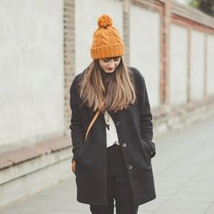 Mustard beanie, Happy sweater, leggings, boots