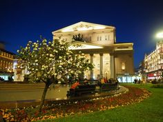 Spring Evening at BolshoiThe sun sets very late in Moscow in May. Spring has arrived and people sit chatting in front of the gorgeous Bolshoi Theatre. There's a huge flowering Daphne t...
