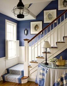 Nantucket entry with white wainscoting, navy wall, blue & white stair runner -- designer: T. Keller Donovan -- photo: John Gould Bessler