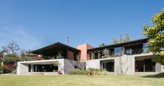 the second house on a hilled site in guadalajara, mexico, the structure has a flexible interior to accommodate changes in the growing family.