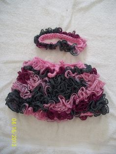 crocheted baby skirt and matching headband. Made with Redheart Sashay and Bernat chunky yarns