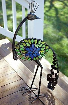 Stained Glass Peacock: Add a tea light to the holder inside to illuminate the jewel tones of the art glass. Crafted in metal with a warm verdigris finish.  (Cool, Brenda!)