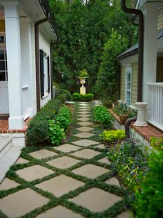 Pavers spaced with grass or groundcover create an attractive garden path. Author Emily Giffin's House in Atlanta