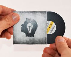 Innovative business card based on the classic vinyl record and sleeve designed by Vitor Bonates
