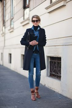 Jeans, long coat, fabulous leather clutch, denim with denim ... all fab!