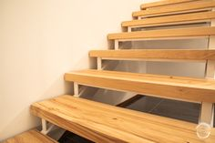 Wooden plank staircase made from solid birch, with white metal handrails. Designed and made by Puuartisti, Finland. Wood Staircase, Stairs, Metal Handrails, Plank, Finland, Birch, Solid Wood, Shelves, Interior Design