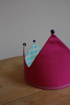A fabric crown, this will last a lot longer than those paper ones.
