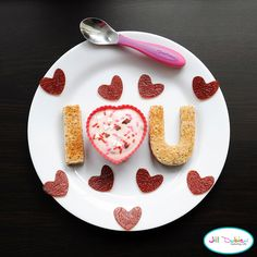 The I and U were made using out of peanut butter toast and my alphbet cutters. I used a heart silicone cup in the middle filled with yogurt and Valentine's sprinkles. Fruit leather hearts all over the plate.