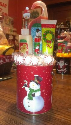 Snowman tin $12. Customize yours today at Tracy's Avon & Custom Gifts. Call today at 440-310-4818.