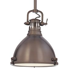 Hudson Valley Lighting's Pelham's bell-shaped shade and cast metal tension clips evoke industrial inspiration. A machine age durable pendant.