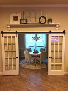 I would put some french doors on a barn door rail because it gives off a vintage look. Having the doors there will give you some privacy if you ever need it. And when the doors are open, it'll feel like there is more space in the dining room. Home Renovation, Home Remodeling, Barn Door Decor, Above Door Decor, Barn Door With Window, Wall Decor, Shelf Above Window, Decor Room, Room Decorations