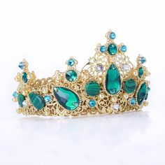 Emerald Swarovski gold crown, wedding tiara,crystal crown,bridesmaid headpiece, green gold headband,green headband,tiara,crown baroque dolce  Fantastic hair accessories for weddings, prom, parties or other special occasions.  - Handmade - Size: 7cm (2.7) high. - Tiara (open front the back) flexible. - **100% FULL MONEY BACK GUARANTEE** Unlike others sellers, WE STAND behind our brand ILoveCrowns and provide 100% FULL MONEY BACK guarantee, if, For Whatever Reason, You dont Absolutly Love your…