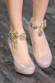 Fabulous lavender heels capped by stunning anklet jewels by Nina Ricci.