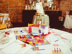 """5) Board Games: Doesn't hurt to set up a separate table or two with cards and/or board games. Kids and adults can have fun playing if dancing isn't their """"thing."""""""