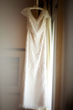 Gorgeous BHLDN gown - the Aurora- US size 4. Full length cream colored gown with intricate beading and sheer cap sleeves. Is very comfortable for dancing all night! Has had no alterations done, but can be shortened (working with an experienced bridal tailor is recommended). Can be worn with a regular strapless bra.