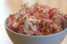 Pretty Pretty Princess Pink Party Popcorn (great idea for a girls slumber party, princess birthday party or anyone who just LOVES pink...bet it's super yummy too!)    Popcorn   Vegetable Oil or Olive Oil   Kosher Salt   8 ounces of good White Chocolate   Red Food Coloring