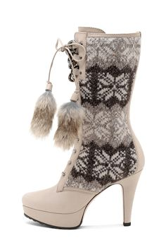 Beige Platform Boot with Fur Pom-Pom and Alpine Sweater Trim  by Sebastian.     These are cute.