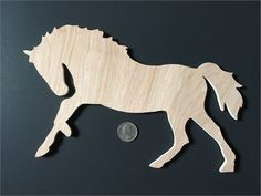"This playful wooden galloping horse was cut by hand using my scroll saw. The edges have been lightly sanded. It has not been stained or painted - only cut and sanded. Use it for craft projects of any kind! Christmas ornament... fridge magnet... mobile... desk decoration... whatever you like! Dimensions: 10 1/2"" long 7 1/4"" wide 1/4"" thick"