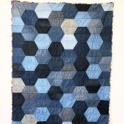 I love working with denim because of the weight of the material, re-using a material that might have been discarded and it's durability. All of the denim used in this quilt lived as…