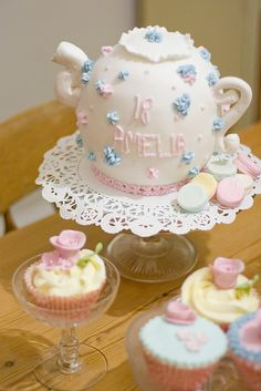 I love the cupcakes in stemware!  And look at the cake -- so very British!