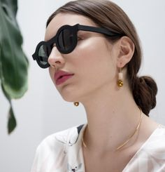 Minimal everyday stone earrings made of yellow jade bead, hematite ball bead and gold filled ear studs. Delicate and fun.    Designed and made in Montreal.