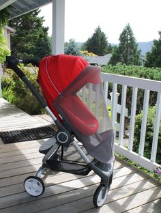 Stokke Scoot stroller in Red with Mosquito Net