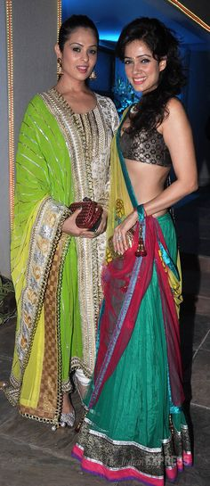 Anjana Sukhani in a green and gold churidar suit, Vidya Malvade in a bronze and black choli top with a green lehenga at a 2013 Diwali Party