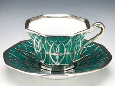 Deco Teacup and Saucer ~ an intricate set of emerald green with silver accenting.  Tirschenreuth, c1927.