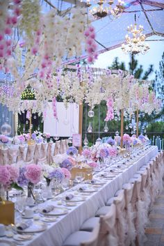Pink and purple hydrangeas and suspended orchids // KC and Meilan's Blissful Resort Wedding