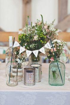Wild flowers filled in old jars - rustic wedding centerpiece in jar #centerepices #jarcenterpieces #rusticwedding