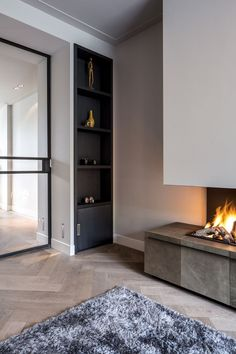 Discover the joy of a good old-fashioned fire with the top 70 best modern fireplace design ideas. Explore luxury built-in features for your home interior. Home Interior Design, Interior Architecture, Interior And Exterior, Modern Interior Doors, Modern Fireplace, Fireplace Design, Muebles Living, Deco Design, Home And Living