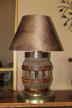 Lamp made out of an old wagon wheel hub we could add a better base and shade.