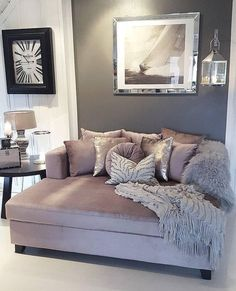 Love this mauve, gray, and white color scheme for the living room-- beautiful couch and throw pillows.