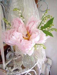 Pink peony with lilly of the valley
