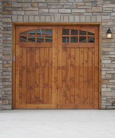 Wood board and batten stained shutters with metal bolts for Wood stained garage doors