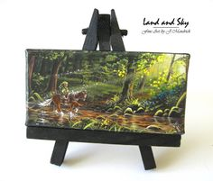 The Journey Begins - Mini  This is a miniaturized version of an original painting I created. There are two variations available to choose from: An easel version designed to be used as desktop art for home / office or a magnet version. This mini artwork is hand assembled from a giclee print on archival glossy canvas with highlights painted on!  Unique to this piece is hand highlights on the rocks and branches to give the mini print texture and help catch the light just like the original full…