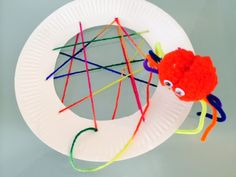 What you need: A paper plate Yarn A pom-pom Googly eyes 4 long pipe cleaners 1 pipe cleaner cut off to match the colour of the pom-pom (about 3cm in length) Knitting needle Scissors Paint the paper plate in a colour of your crafty kids choice. Once dry, cut a large circular hole out of …