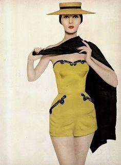 Dovima, photo by Avedon, Harper's Bazaar, December 1954   flickr skorver1