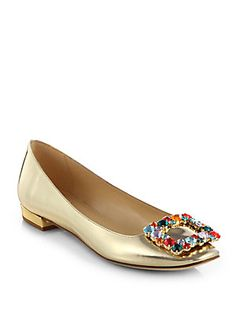 Kate Spade New York Norella Metallic Leather Rhinestone Buckle Ballet FlatsCut from lustrous Italian leather, this timeless flat is topped with a rhinestone-encrusted buckle for an eye-catching pop of contrast. Metallic leather upper Leather lining and sole Padded insole Made in Italy