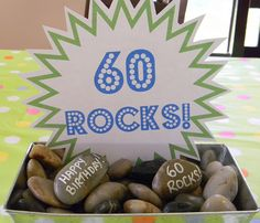 Have everyone write a little note on each rock! (Happy birthday! Stuff like that) And if you can't find 60 people write little quirky, fun things