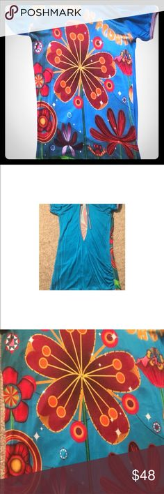 Custo Barcelona rare flower print open back top Iconic Custo colorful print. Fits loose and fitted at the bottom. The back is exposed: sexy , fun , understated. Dress up with dress denim and pumps or down with a denim skirt. Never worn. Flower print with crystal 3D detail. Custo Barcelona Tops Tunics