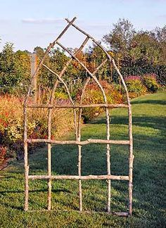 Garden Trellis made with sticks you can find in the woods or even on the sidewalks of your neighborhood (especially after a windy day!)