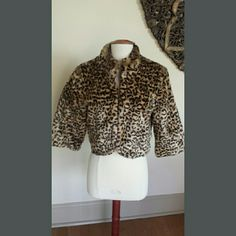 Leopard Faux Fur Retro Shrug with 3/4 Sleeves Very cute retro looking faux fur shrug with hot pink lining & three-quarter sleeves. New with tags. Size M - faux fur made from 93% acrylic 7% polyester - lining made from 100% polyester. Measures 18 inches long from seam at top of shoulder to bottom of jacket - sleeves measure 16.5 inches long from top seam to end of sleeve & 10.5 inches long from seam underarm to bottom of sleeve. Has two hooks in the front for closure. XXI Jackets & Coats